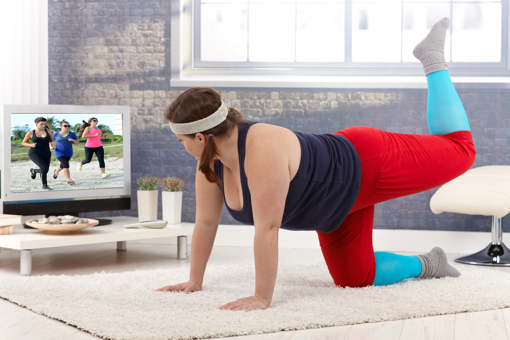 girl exercising in front of tv copy.jpg